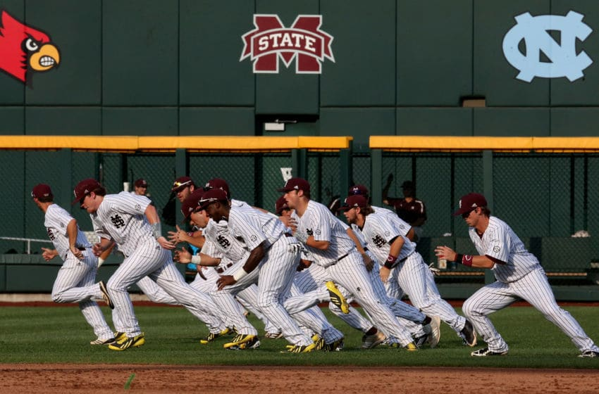 OMAHA, NE - JUNE 24: The Mississippi State Bulldogs run in the outfield to warm up before playing the UCLA Bruins during game one of the College World Series Finals on June 24, 2013 at TD Ameritrade Park in Omaha, Nebraska. UCLA won 3-1. (Photo by Stephen Dunn/Getty Images)