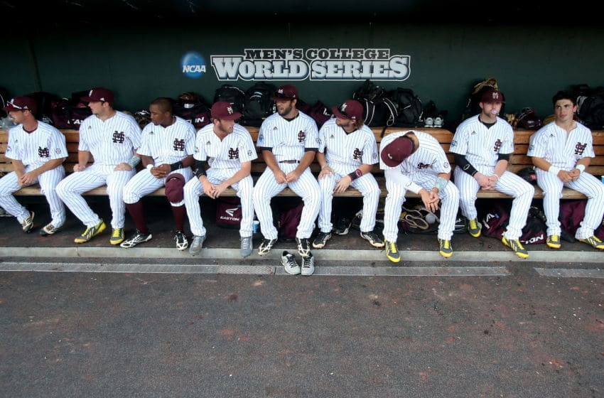 OMAHA, NE - JUNE 24: Mississippi State Bulldogs players sit in the dugout before playing the UCLA Bruins during game one of the College World Series Finals on June 24, 2013 at TD Ameritrade Park in Omaha, Nebraska. UCLA won 3-1. (Photo by Stephen Dunn/Getty Images)