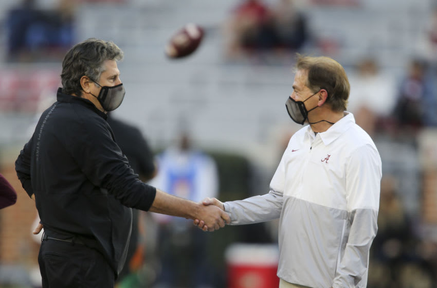 Oct 31, 2020; Tuscaloosa, Alabama, USA; Mississippi State head coach Mike Leach and Alabama head coach Nick Saban greet each other before the game at Bryant-Denny Stadium. Mandatory Credit: Gary Cosby Jr/The Tuscaloosa News via USA TODAY Sports