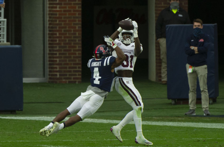 Nov 28, 2020; Oxford, Mississippi, USA; Mississippi State Bulldogs wide receiver Jaden Walley (31) catches a pass against Mississippi Rebels defensive back Tylan Knight (4) during the first half at Vaught-Hemingway Stadium. Mandatory Credit: Justin Ford-USA TODAY Sports