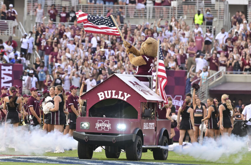 Sep 11, 2021; Starkville, Mississippi, USA; Mississippi State Bulldogs mascot Bully waves an American flag before the game against the North Carolina State Wolfpack at Davis Wade Stadium at Scott Field. Mandatory Credit: Matt Bush-USA TODAY Sports