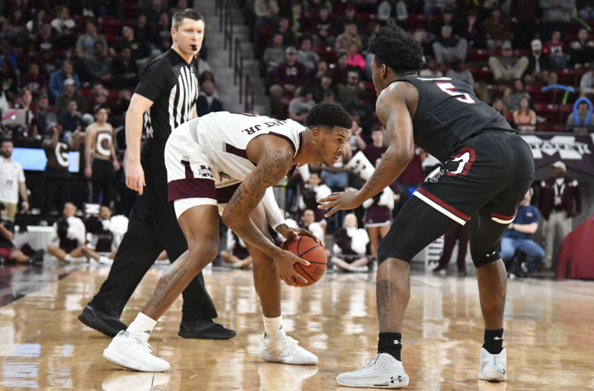 Feb 19, 2020; Starkville, Mississippi, USA; Mississippi State Bulldogs guard D.J. Stewart Jr. (3) handles the ball while defended by South Carolina Gamecocks guard Jermaine Couisnard (5) during the first half at Humphrey Coliseum. Mandatory Credit: Matt Bush-USA TODAY Sports