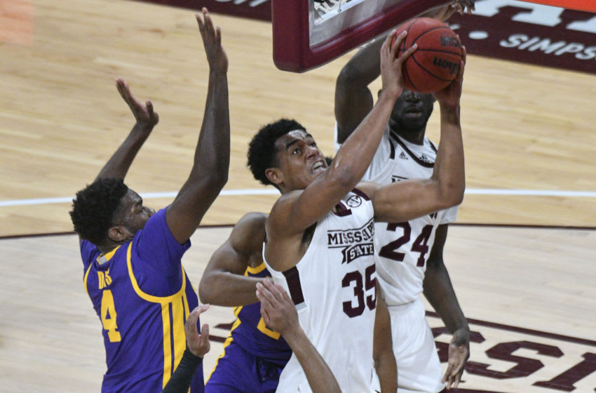 Feb 10, 2021; Starkville, Mississippi, USA; Mississippi State Bulldogs forward Tolu Smith (35) goes up for a shot while defended by LSU Tigers forward Darius Days (4) during the first half at Humphrey Coliseum. Mandatory Credit: Matt Bush-USA TODAY Sports
