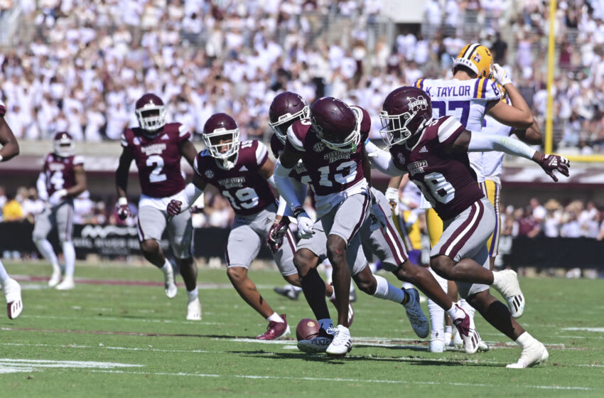 Sep 25, 2021; Starkville, Mississippi, USA; Mississippi State Bulldogs cornerback Emmanuel Forbes (13) reacts with teammates after an interception against the LSU Tigers during the second quarter at Davis Wade Stadium at Scott Field. Mandatory Credit: Matt Bush-USA TODAY Sports