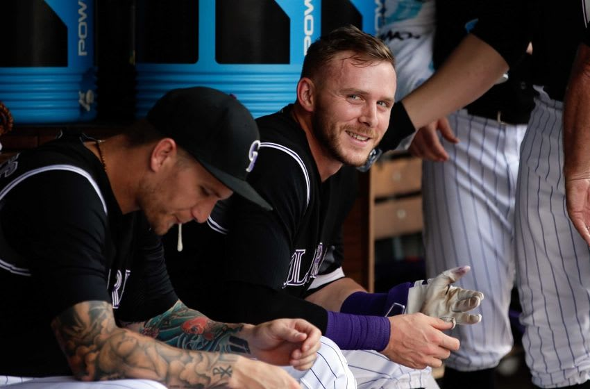 Jul 24, 2016; Denver, CO, USA; Colorado Rockies shortstop Trevor Story (27) smiles in the dugout after hitting a two run home run in the fourth inning against the Atlanta Braves at Coors Field. Mandatory Credit: Isaiah J. Downing-USA TODAY Sports