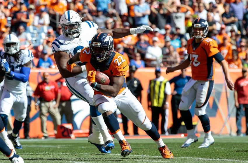 Sep 18, 2016; Denver, CO, USA; Denver Broncos running back C.J. Anderson (22) runs for a touchdown ahead of Indianapolis Colts defensive end Zach Kerr (94) in the second quarter at Sports Authority Field at Mile High. Mandatory Credit: Isaiah J. Downing-USA TODAY Sports