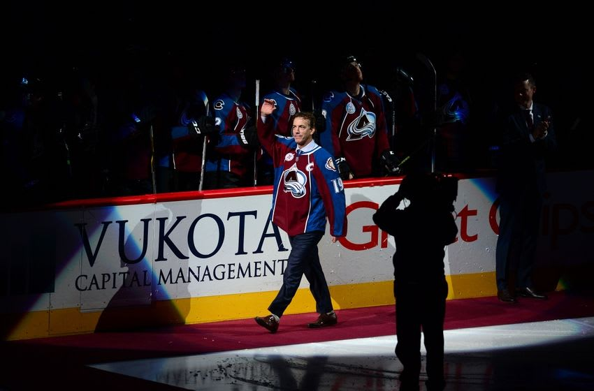 Dec 7, 2015; Denver, CO, USA; Colorado Avalanche general manager Joe Sakic fans waves to the crowd before the game against the Minnesota Wild at Pepsi Center. Mandatory Credit: Ron Chenoy-USA TODAY Sports