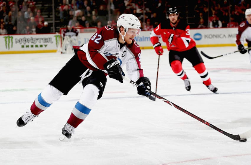 NEWARK, NJ - OCTOBER 18: Gabriel Landeskog #92 of the Colorado Avalanche plays the puck against the New Jersey Devils during the game at Prudential Center on October 18, 2018 in Newark, New Jersey. (Photo by Andy Marlin/NHLI via Getty Images)