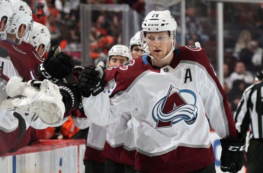PHILADELPHIA, PA - OCTOBER 22: Nathan McKinnon #29 of the Colorado Avalanche celebrates a first period goal with teammates on the bench against the Philadelphia Flyers on October 22, 2018 at the Wells Fargo Center in Philadelphia, Pennsylvania. (Photo by Len Redkoles/NHLI via Getty Images)