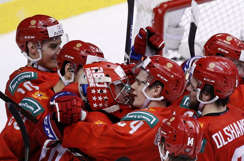 VANCOUVER , BC - JANUARY 5: Goaltender Pyotr Kochetkov #20 and team captain Klim Kostin #24 celebrate with teammates following a bronze medal win over Switzerland at the IIHF World Junior Championships at Rogers Arena on January 5, 2019 in Vancouver, British Columbia, Canada. (Photo by Kevin Light/Getty Images)