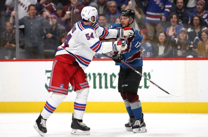 DENVER, COLORADO - JANUARY 04: Adam McQuaid #54 of the New York Rangers and Tyson Jost #17 of the Colorado Avalanche fight in the third period at the Pepsi Center on January 04, 2019 in Denver, Colorado. (Photo by Matthew Stockman/Getty Images)