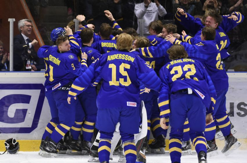 Sweden players celebrate their 4-3 win after a goal by Lucas Raymond during the 2019 Ice Hockey U18 World Championships final match between Sweden and Russia on April 28, 2019, at Fjallraven Center in Ornskoldsvik, Sweden. (Photo by Erik MARTENSSON / TT News Agency / AFP) / Sweden OUT (Photo credit should read ERIK MARTENSSON/AFP via Getty Images)