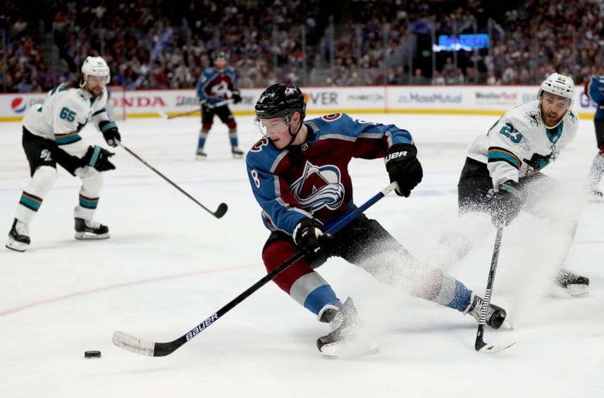DENVER, COLORADO - MAY 06: Cale Makar #8 of the Colorado Avalanche skates the puck away from Barclay Goodrow #23 of the San Jose Sharks in the second period during Game Six of the Western Conference Second Round during the 2019 NHL Stanley Cup Playoffs at the Pepsi Center on May 6, 2019 in Denver, Colorado. (Photo by Matthew Stockman/Getty Images)