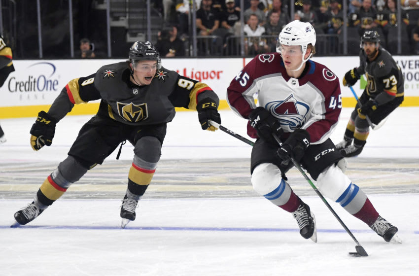 LAS VEGAS, NEVADA - SEPTEMBER 25: Bowen Byram #45 of the Colorado Avalanche skates with the puck against Cody Glass #9 of the Vegas Golden Knights in the second period of their preseason game at T-Mobile Arena on September 25, 2019 in Las Vegas, Nevada. (Photo by Ethan Miller/Getty Images)