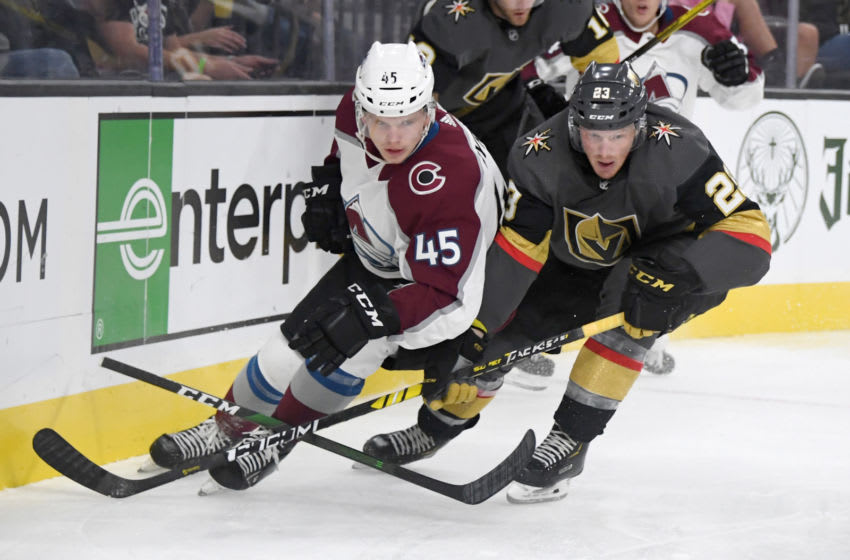 LAS VEGAS, NEVADA - SEPTEMBER 25: Bowen Byram #45 of the Colorado Avalanche and Patrick Brown #23 of the Vegas Golden Knights go after the puck in the second period of their preseason game at T-Mobile Arena on September 25, 2019 in Las Vegas, Nevada. (Photo by Ethan Miller/Getty Images)