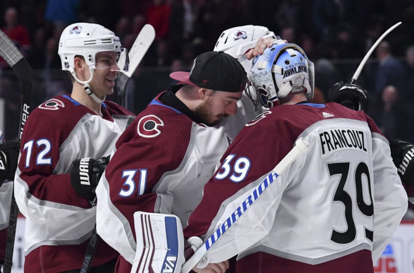 MONTREAL, QC - DECEMBER 5: Goalies Pavel Francouz #39 and Philipp Grubauer #31 of the Colorado Avalanche celebrate after defeating the Montreal Canadiens in the NHL game at the Bell Centre on December 5, 2019 in Montreal, Quebec, Canada. (Photo by Francois Lacasse/NHLI via Getty Images)