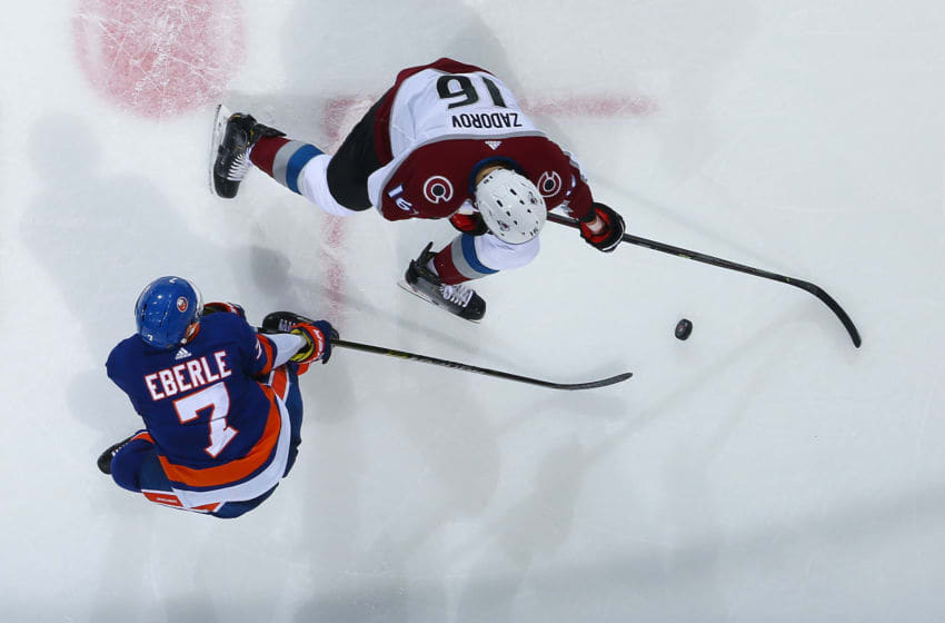 UNIONDALE, NEW YORK - JANUARY 06: Mathew Barzal #13 of the New York Islanders faces-off against Nazem Kadri #91 of the Colorado Avalanche at NYCB Live's Nassau Coliseum on January 06, 2020 in Uniondale City. New York Islanders defeated the Colorado Avalanche 2-1. (Photo by Mike Stobe/NHLI via Getty Images)