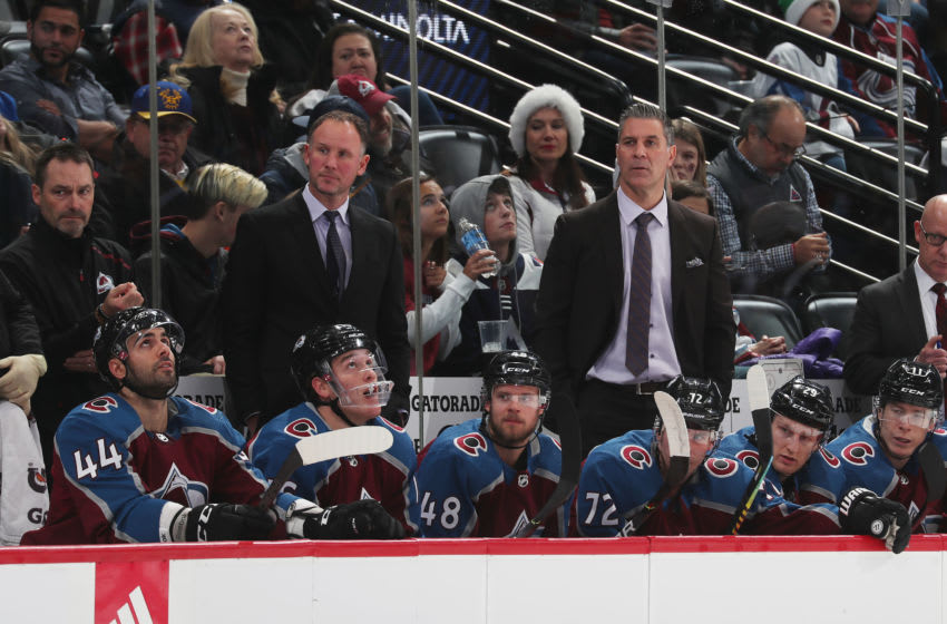 DENVER, COLORADO - DECEMBER 13: Assistant coach Nolan Pratt and head coach Jared Bednar of the Colorado Avalanche look on against the New Jersey Devils at Pepsi Center on December 13, 2019 in Denver, Colorado. (Photo by Michael Martin/NHLI via Getty Images)
