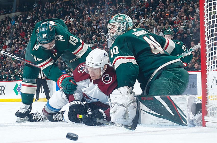 SAINT PAUL, MN - FEBRUARY 9: Luke Kunin #19 and Devan Dubnyk #40 of the Minnesota Wild knock the puck away from Matt Calvert #11 of the Colorado Avalanche during the game at the Xcel Energy Center on February 9, 2020 in Saint Paul, Minnesota. (Photo by Bruce Kluckhohn/NHLI via Getty Images)