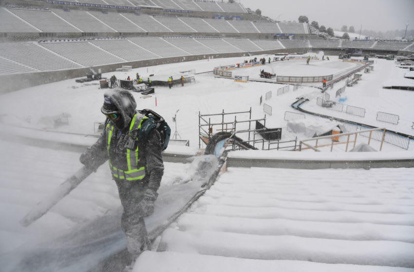 COLORADO SPRINGS, CO - FEBRUARY 7: Crews are moving snows from the stand during the ongoing buildout of the NHL Stadium Series outdoor game played at Falcon Stadium of Air Force Academy in Colorado Springs, Colorado on Friday. February 7, 2020. (Photo by Hyoung Chang/MediaNews Group/The Denver Post via Getty Images)