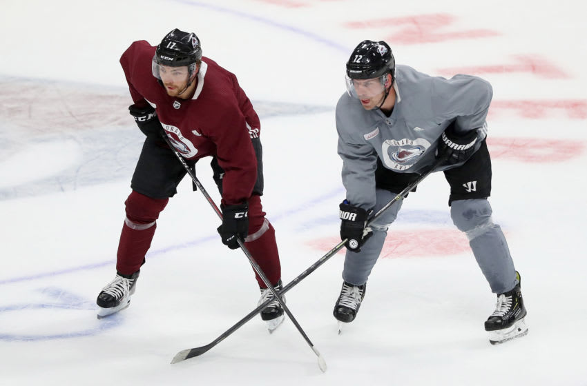 DENVER, COLORADO - JULY 15: Tyson Jost #17 and Joonas Donskoi #72 of the Colorado Avalanche match up during training camp at the Pepsi Center on July 15, 2020 in Denver, Colorado. (Photo by Matthew Stockman/Getty Images)