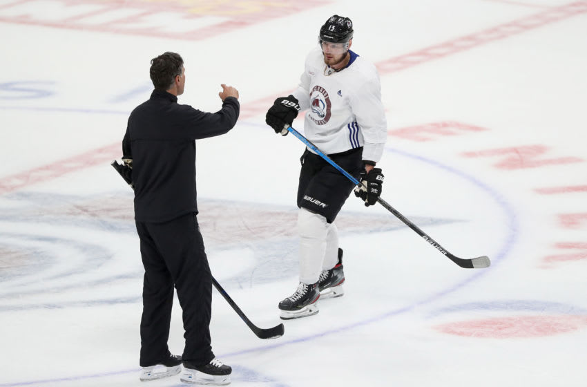 DENVER, COLORADO - JULY 15: Coach Jared Bednar of the Colorado Avalanche speaks to Valeri Nichushkin #13 during training camp at the Pepsi Center on July 15, 2020 in Denver, Colorado. (Photo by Matthew Stockman/Getty Images)