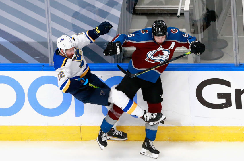 EDMONTON, ALBERTA - AUGUST 02: Zach Sanford #12 of the St. Louis Blues and Erik Johnson #6 of the Colorado Avalanche collide during the second period in a Round Robin game during the 2020 NHL Stanley Cup Playoff at the Rogers Place on August 02, 2020 in Edmonton, Alberta, Canada. (Photo by Jeff Vinnick/Getty Images)