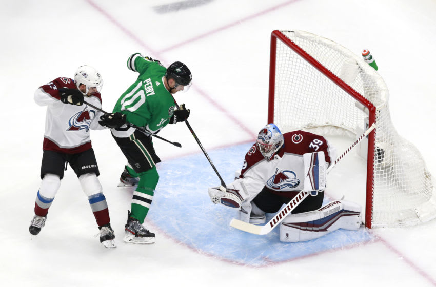 EDMONTON, ALBERTA - AUGUST 05: Corey Perry #10 of the Dallas Stars tries to get the shot past Pavel Francouz #39 of the Colorado Avalanche as Matt Nieto #83 of the Colorado Avalanche defends in the first period in a Western Conference Round Robin game during the 2020 NHL Stanley Cup Playoff at Rogers Place on August 05, 2020 in Edmonton, Alberta. (Photo by Jeff Vinnick/Getty Images)