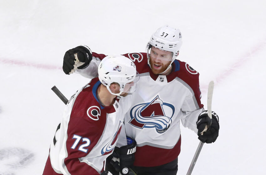 EDMONTON, ALBERTA - AUGUST 05: Joonas Donskoi #72 of the Colorado Avalanche is congratulated by teammate J.T. Compher #37 after he scored a goal in the first period against the Dallas Stars in a Western Conference Round Robin game during the 2020 NHL Stanley Cup Playoff at Rogers Place on August 05, 2020 in Edmonton, Alberta. (Photo by Jeff Vinnick/Getty Images)