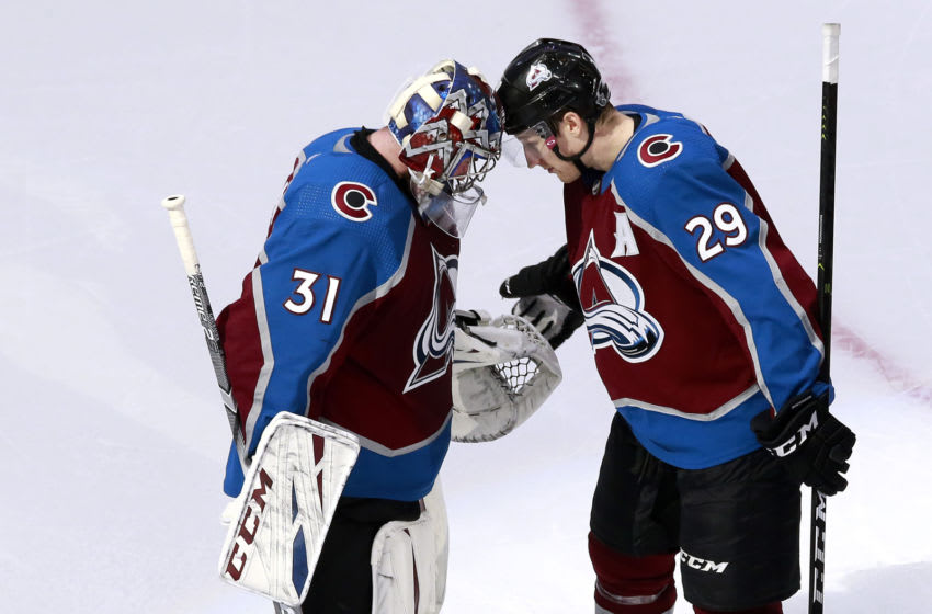 EDMONTON, ALBERTA - AUGUST 12: Philipp Grubauer #31 of the Colorado Avalanche celebrates with Nathan MacKinnon #29 after defeating the Arizona Coyotes in Game One of the Western Conference First Round during the 2020 NHL Stanley Cup Playoffs at Rogers Place on August 12, 2020 in Edmonton, Alberta, Canada. (Photo by Jeff Vinnick/Getty Images)