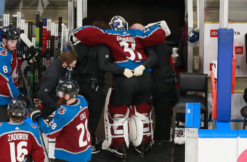 EDMONTON, ALBERTA - AUGUST 22: Philipp Grubauer #31 of the Colorado Avalanche is taken off the ice by trainers following a second period injury against the Dallas Stars in Game One of the Western Conference Second Round during the 2020 NHL Stanley Cup Playoffs at Rogers Place on August 22, 2020 in Edmonton, Alberta, Canada. (Photo by Jeff Vinnick/Getty Images)