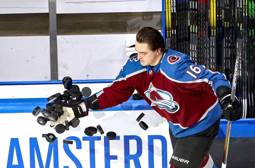EDMONTON, ALBERTA - SEPTEMBER 04: Nikita Zadorov #16 of the Colorado Avalanche knocks the pucks off the boards during warmups prior to Game Seven of the Western Conference Second Round against the Dallas Stars during the 2020 NHL Stanley Cup Playoffs at Rogers Place on September 04, 2020 in Edmonton, Alberta, Canada. (Photo by Bruce Bennett/Getty Images)
