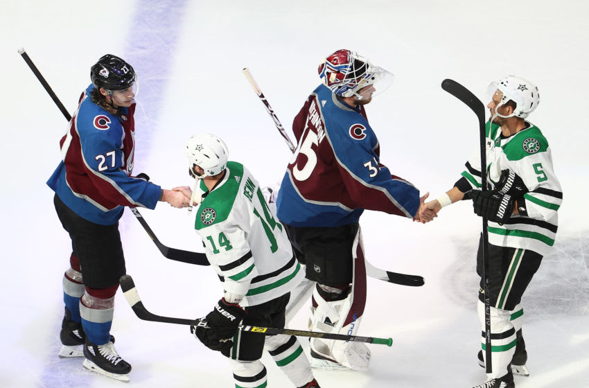 EDMONTON, ALBERTA - SEPTEMBER 04: Ryan Graves #27 and Michael Hutchinson #35 of the Colorado Avalanche shake hands with Jamie Benn #14 and Andrej Sekera #5 of the Dallas Stars after the 5-4 overtime victory by the Stars in Game Seven of the Western Conference Second Round during the 2020 NHL Stanley Cup Playoffs at Rogers Place on September 04, 2020 in Edmonton, Alberta, Canada. (Photo by Bruce Bennett/Getty Images)