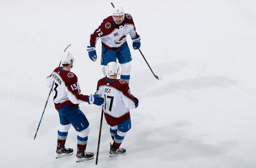 GLENDALE, ARIZONA - MARCH 22: Joonas Donskoi #72 of the Colorado Avalanche celebrates with Valeri Nichushkin #13 and Tyson Jost #17 after scoring a goal against the Arizona Coyotes during the third period of the NHL game at Gila River Arena on March 22, 2021 in Glendale, Arizona. The Avalanche defeated the Coyotes 5-1. (Photo by Christian Petersen/Getty Images)