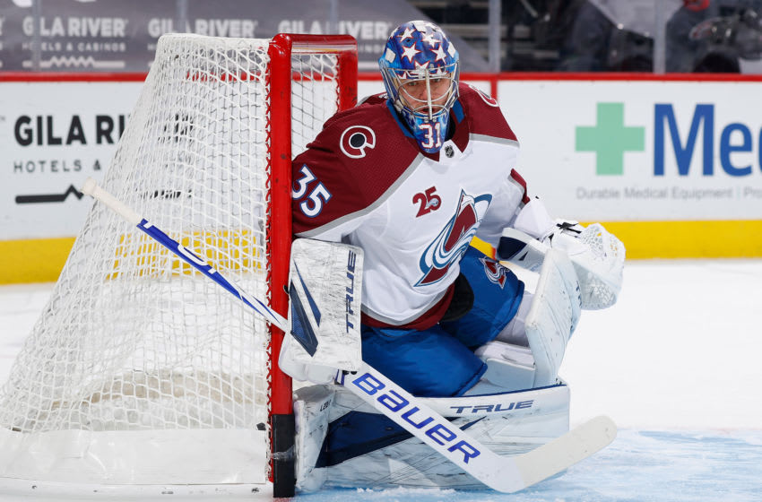 GLENDALE, ARIZONA - MARCH 22: Goaltender Jonas Johansson #35 of the Colorado Avalanche warms up before the NHL game against the Arizona Coyotes at Gila River Arena on March 22, 2021 in Glendale, Arizona. The Avalanche defeated the Coyotes 5-1. (Photo by Christian Petersen/Getty Images)