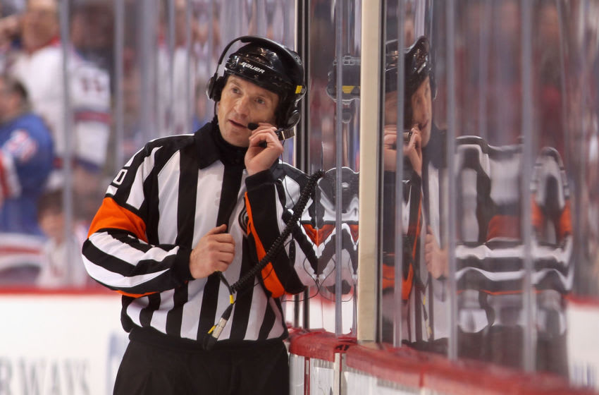 GLENDALE, AZ - DECEMBER 17: Referre Tim Peel talks with NHL officials in Toronto as they review Brad Richards #19 of the New York Rangers goal in the final second during the NHL game against the Phoenix Coyotes at Jobing.com Arena on December 17, 2011 in Glendale, Arizona. The Rangers defeated the Coyotes 3-2. (Photo by Christian Petersen/Getty Images)