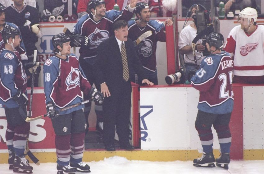 22 May 1997: Colorado Avalanche head coach Marc Crawford (center) yells during a playoff game against the Detroit Red Wings at Joe Louis Arena in Detroit, Michigan. The Red Wings won the game, 6-0. Mandatory Credit: Jason Wise /Allsport
