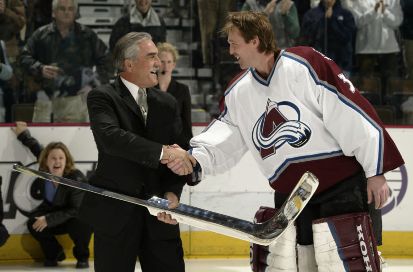DENVER - JANUARY 20: Former Kings goaltender Rogie Vachon presents goalie Patrick Roy #33 of the Colorado Avalanche with a silver stick before his 1000th game on January 20, 2003 at the Pepsi Center in Denver, Colorado. (Photo by Brian Bahr/Getty Images/NHLI)