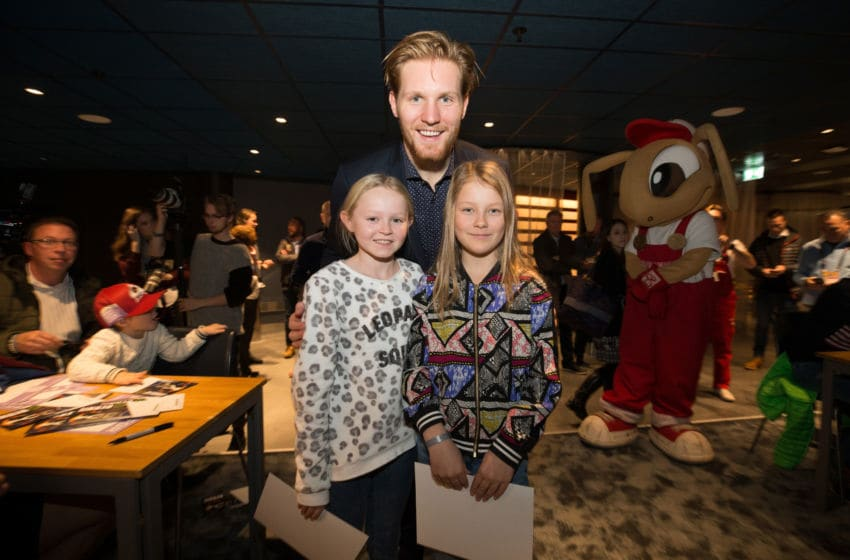STOCKHOLM, SWEDEN - NOVEMBER 07: Gabriel Landeskog #92 of the Colorado Avalanche poses with kids from the Swedish Childhood Cancer Foundation (bauhaus) at the Ericsson Globe on November 7, 2017 in Stockholm, Sweden. (Photo by Michael Martin/NHLI via Getty Images)
