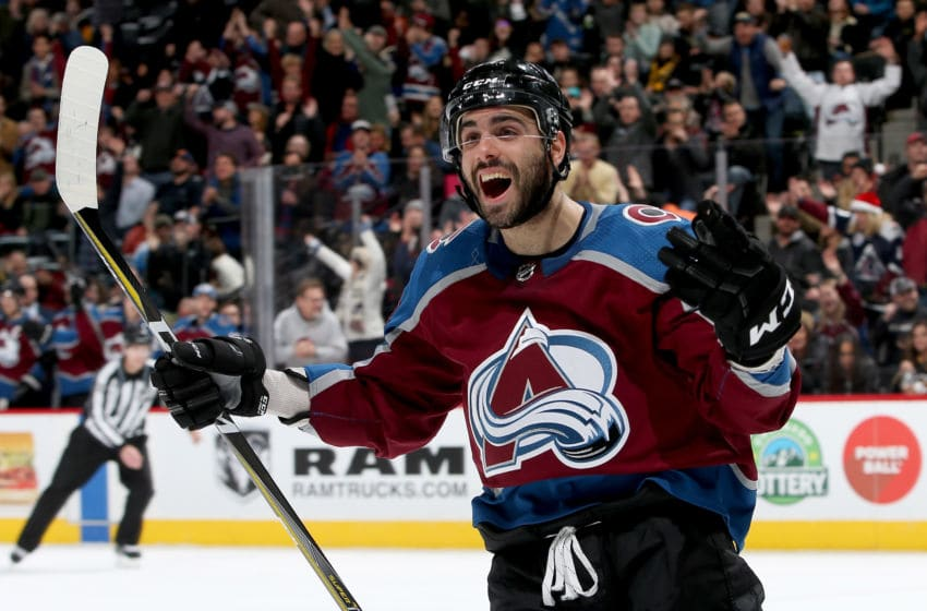 DENVER, CO - DECEMBER 18: Mark Barberio #44 of the Colorado Avalanche celebrates a J.T. Compher goal against the Pittsburgh Penguins at the Pepsi Center on December 18, 2017 in Denver, Colorado. (Photo by Matthew Stockman/Getty Images)