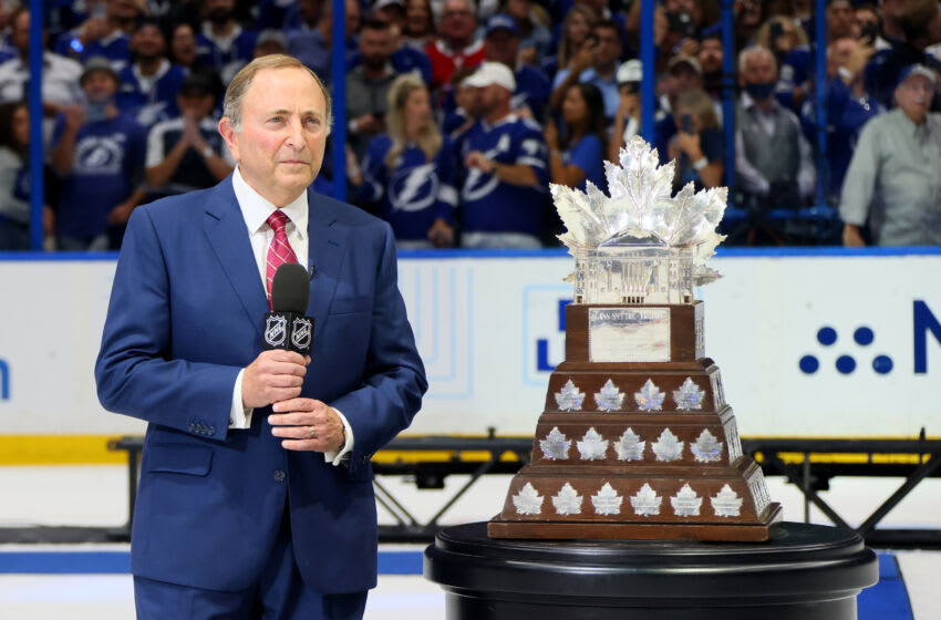 TAMPA, FLORIDA - JULY 07: NHL Commisioner Gary Bettman stands next to the Conn Smythe Trophy after the Tampa Bay Lightning defeated the Montreal Canadiens 1-0 in Game Five to win the 2021 NHL Stanley Cup Final at Amalie Arena on July 07, 2021 in Tampa, Florida. (Photo by Bruce Bennett/Getty Images)