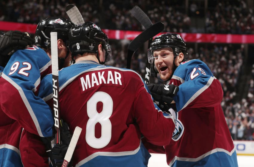 DENVER, CO - APRIL 15: Cale Makar #8 of the Colorado Avalanche celebrates with teammates Gabriel Landeskog #92 and Nathan MacKinnon #29 after scoring his first career NHL goal in his first NHL game against the Calgary Flames in Game Three of the Western Conference First Round during the 2019 NHL Stanley Cup Playoffs at the Pepsi Center on April 15, 2019 in Denver, Colorado. (Photo by Michael Martin/NHLI via Getty Images)