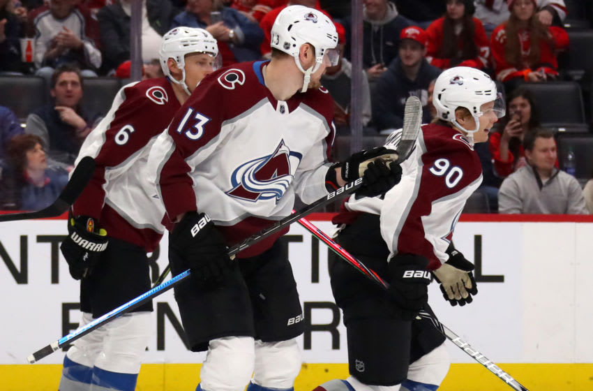 DETROIT, MICHIGAN - MARCH 02: Vladislav Namestnikov #90 of the Colorado Avalanche celebrates his first period goal with Valeri Nichushkin #13 and Erik Johnson #6 while playing the Detroit Red Wings at Little Caesars Arena on March 02, 2020 in Detroit, Michigan. (Photo by Gregory Shamus/Getty Images)