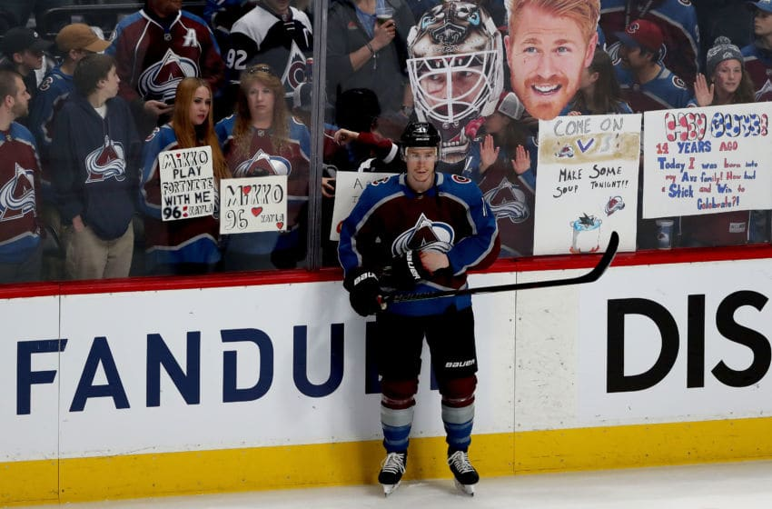 DENVER, COLORADO - MAY 02: Fans line the glass while Matt Calvert #11 of the Colorado Avalanche prepares to play the San Jose Sharks during Game Four of the Western Conference Second Round during the 2019 NHL Stanley Cup Playoffs at the Pepsi Center on May 2, 2019 in Denver, Colorado. (Photo by Matthew Stockman/Getty Images)