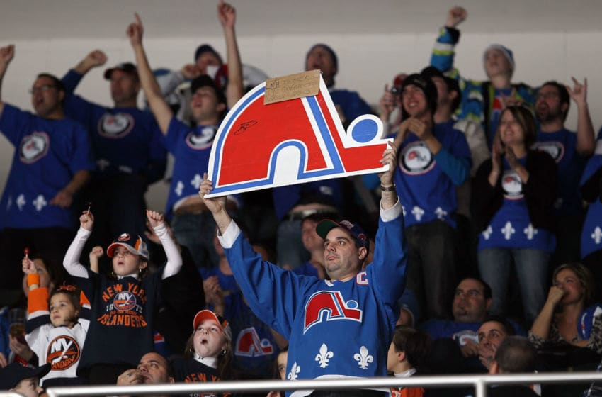 UNIONDALE, NY - DECEMBER 11: Members of 'Nordiques Nation' cheer during the NHL game between the New York Islanders and the Atlanta Thrashers on December 11, 2010 at Nassau Coliseum in Uniondale, New York. Over 1,100 fans from Quebec attended the game to prove their support for an NHL team. (Photo by Jim McIsaac/Getty Images)