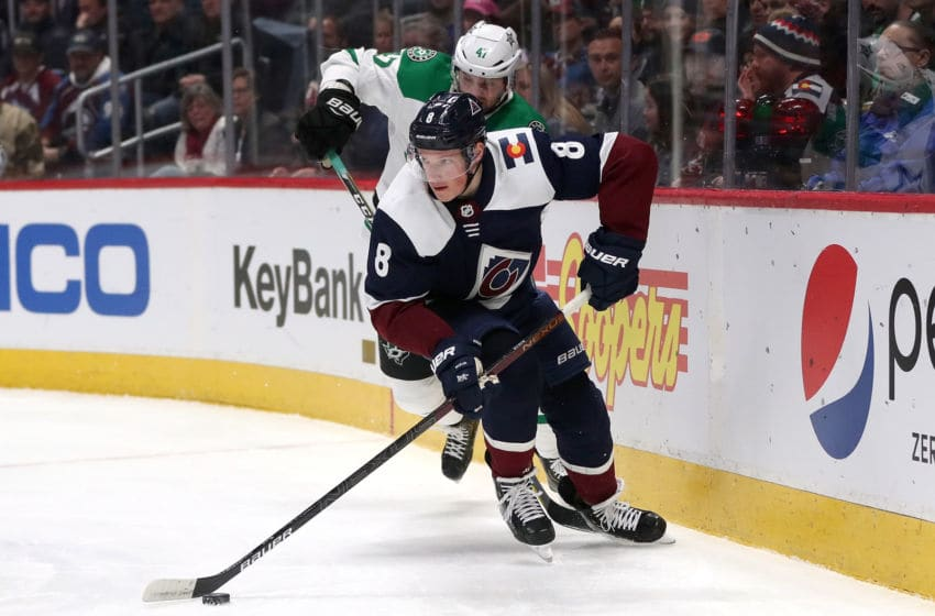 DENVER, COLORADO - JANUARY 14: Cale Makar #8 of the Colorado Avalanche brings the puck off the boards against Alexander Radulov #47 of the Dallas Stars in the first period at the Pepsi Center on January 14, 2020 in Denver, Colorado. (Photo by Matthew Stockman/Getty Images)