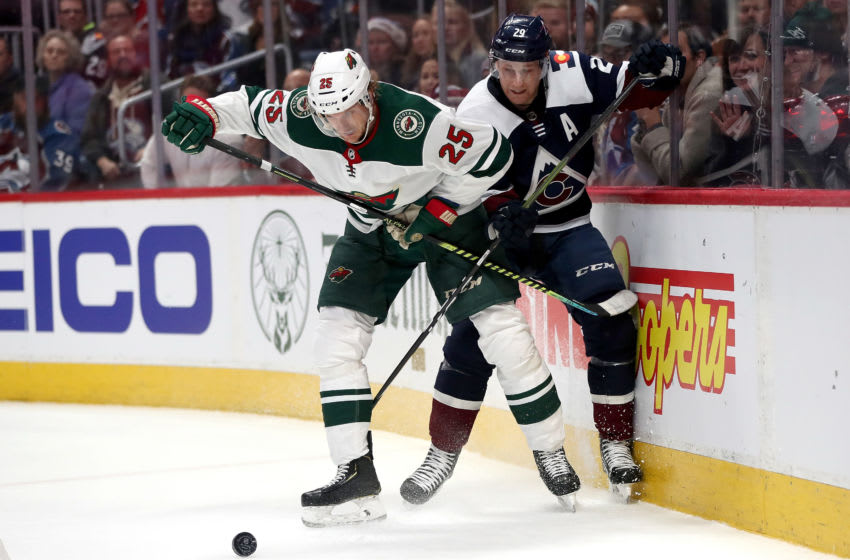 DENVER, COLORADO - DECEMBER 27: Jonas Brodin #25 of the Minnesota Wild fights for the puck against Nathan MacKinnon #29 of the Colorado Avalanche in the second period at the Pepsi Center on December 27, 2019 in Denver, Colorado. (Photo by Matthew Stockman/Getty Images)