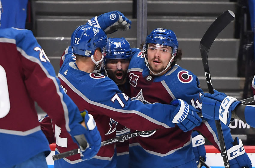 Jan 28, 2021; Denver, Colorado, USA; Colorado Avalanche center Nazem Kadri (center) celebrates his goal with right wing Joonas Donskoi (72) and defenseman Samuel Girard (49) in the third period against the San Jose Sharks at Ball Arena. Mandatory Credit: Ron Chenoy-USA TODAY Sports