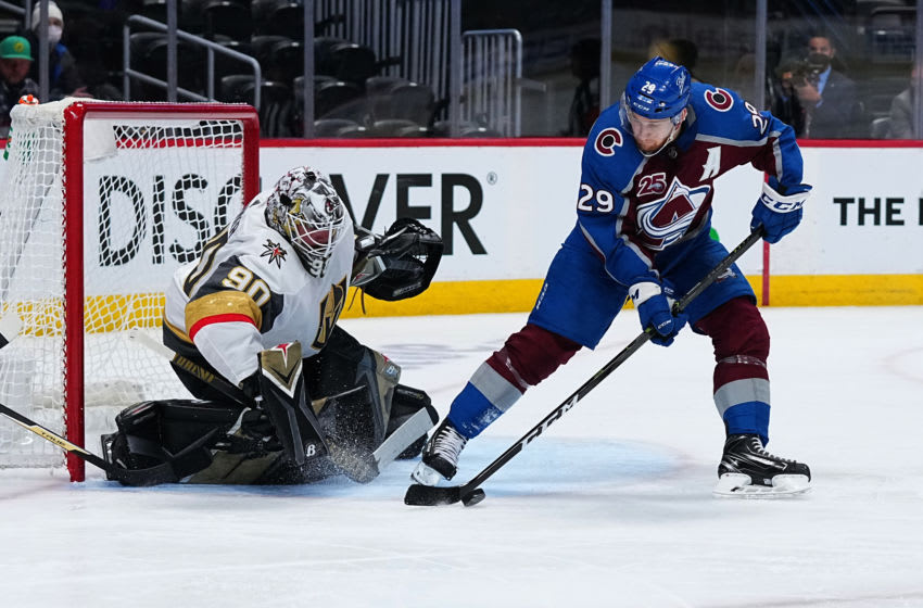 May 30, 2021; Denver, Colorado, USA; Colorado Avalanche center Nathan MacKinnon (29) controls the puck in front of Vegas Golden Knights goaltender Robin Lehner (90) in the third period of game one in the second round of the 2021 Stanley Cup Playoffs at Ball Arena. Mandatory Credit: Ron Chenoy-USA TODAY Sports