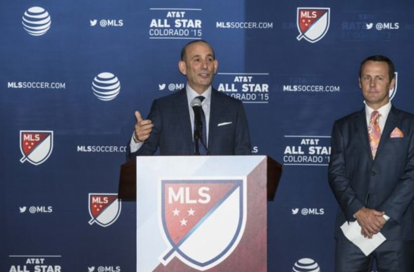 Jul 27, 2015; Denver, CO, USA; MLS commissioner Don Garber (center) speaks at the MLS All-Star welcome reception at Union Station. Mandatory Credit: Isaiah J. Downing-USA TODAY Sports